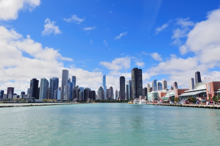 chicago skyline: Chicago city downtown urban skyline with skyscrapers over Lake Michigan with cloudy blue sky.