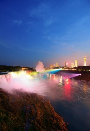 Niagara Falls lit at night by colorful lights photo
