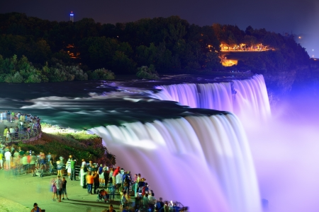 canada: Niagara Falls lit at night by colorful lights