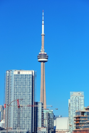 buit in: TORONTO, CANADA - JULY 2: CN Tower closeup on July 2, 2012 in Toronto. Buit in 1976 as the unique landmark of Toronto, it was worlds tallest tower for 34 years