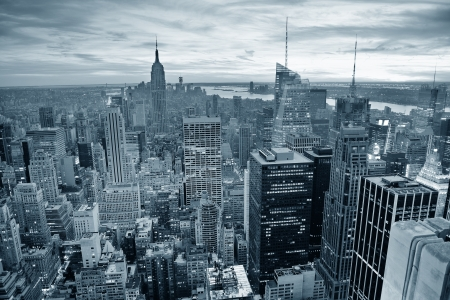 black and white: New York City skyline black and white with urban skyscrapers at sunset. Stock Photo