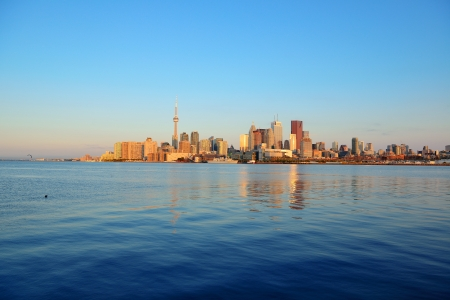 Toronto sunrise with sunlight reflection over lake in the morning photo