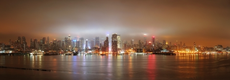 New York City Manhattan midtown panorama skyline at night with skyscrapers over Hudson River viewed from New Jersey. Stock Photo