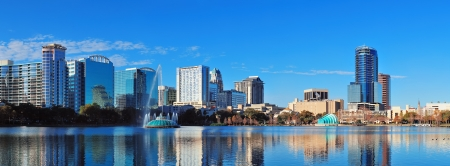 orlando: Orlando Lake Eola in the morning with urban skyscrapers and clear blue sky