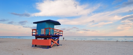 miami south beach: Miami South Beach sunset with lifeguard tower and coastline with colorful cloud and blue sky  Stock Photo