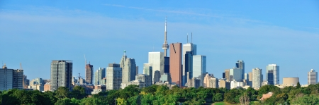 Toronto skyline over park with urban buildings and blue sky Stock Photo - 16385827
