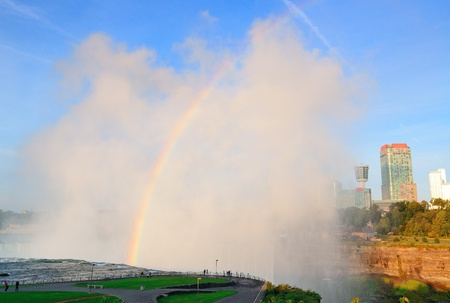 horseshoe falls: Rainbow in mist from Horseshoe Falls in Niagara Falls in the morning after sunrise