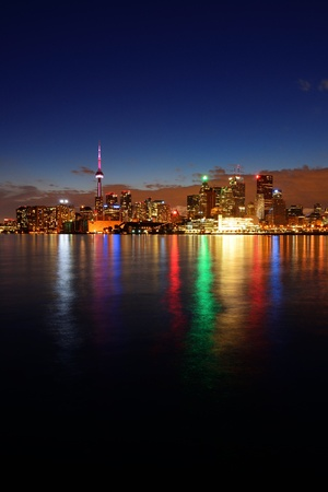 Toronto cityscape panorama at dusk over lake with colorful light. Stock Photo - 17398560
