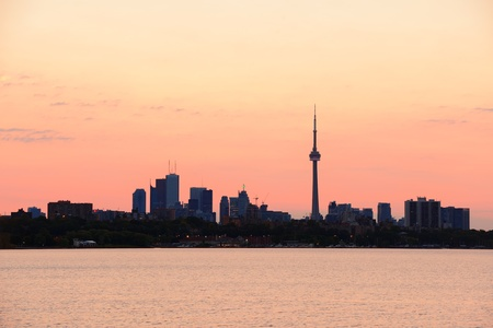 Toronto sunrise silhouette over lake with red tone. Stock Photo - 17400676