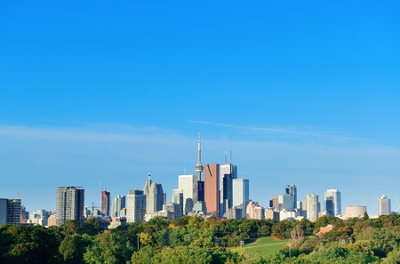 Toronto skyline over park with urban buildings and blue sky Stock Photo - 17398316