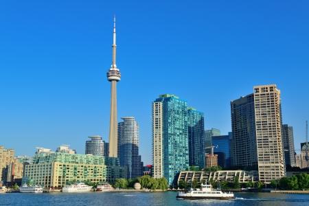 building cn tower: Toronto skyline panorama over lake with urban architecture.
