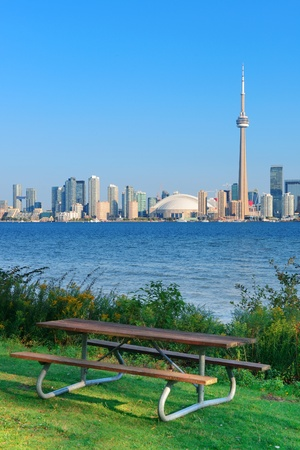 Toronto skyline in the day over lake with urban architecture viewed from park photo