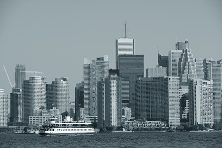Toronto skyline in the day over lake with urban architecture. photo