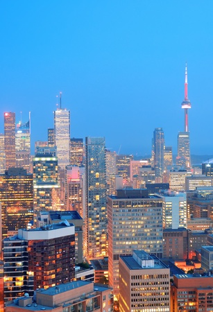 Toronto at dusk with city light and urban skyline with skyscrapers Stock Photo - 17400556