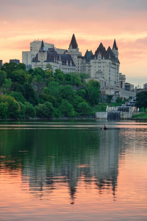 Ottawa city skyline at sunrise in the morning over river with urban historical buildings and colorful cloud photo