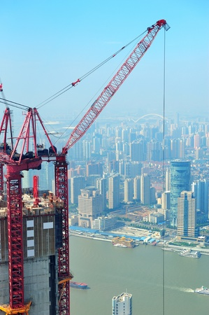 famous industries:  Skyscraper under construction in Shanghai Stock Photo