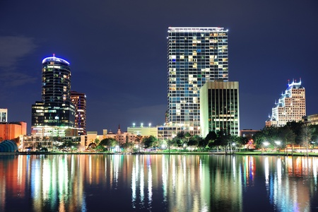 Urban architecture with Orlando downtown skyline over Lake Eola at dusk  Stock Photo - 17400108