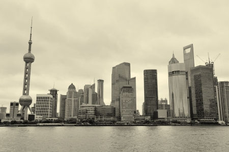 pudong district: Shanghai architecture over river in overcast day Stock Photo