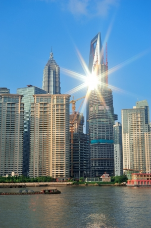 huangpu: Shanghai urban architecture and skyline with sun light reflection over river