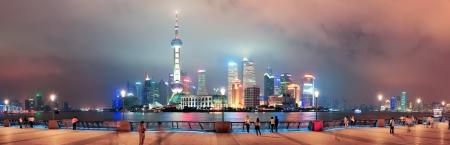 Shanghai urban city skyline over walkway at night photo