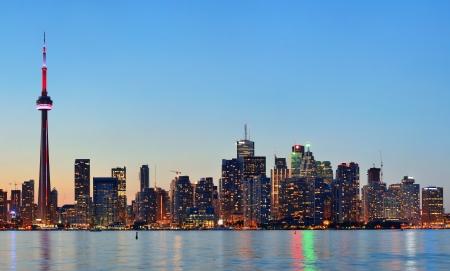 Toronto sunset over lake panorama with urban skyline