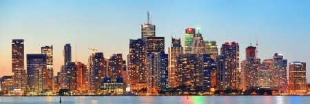 Toronto cityscape panorama at dusk over lake with colorful light  photo
