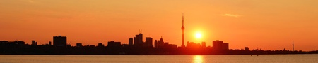 Toronto sunrise silhouette over lake with red tone Stock Photo - 17454587