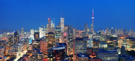 building cn tower: Toronto at dusk with city light and urban skyline with skyscrapers Stock Photo