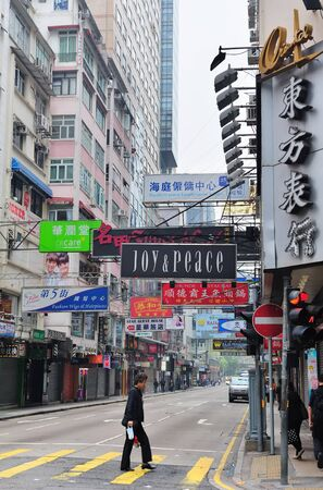 sq: HONG KONG, CHINA - APR 23: Street view with traffic and shops on April 23, 2012 in Hong Kong, China. With 7M population and land mass of 1104 sq km, it is one of the most dense areas in the world.