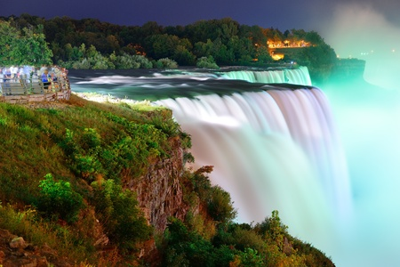 Niagara Falls lit at night by colorful lights photo