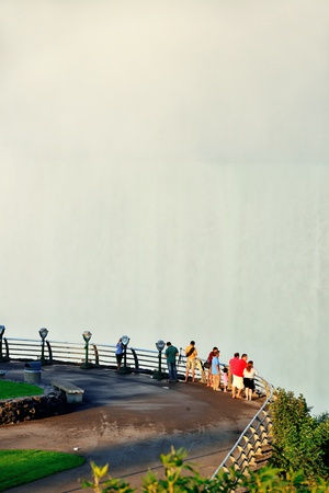 horseshoe falls: NIAGARA FALLS, NY - SEPT 1: Mist arise from Horseshoe Falls with visitors on September 1, 2012 in Niagara Falls, New York. Niagara Falls is the waterfalls with the highest flow rate in the world.