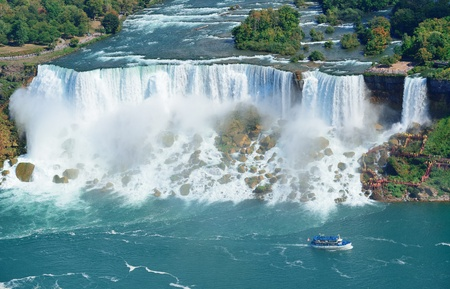 canada day: Niagara Falls closeup panorama in the day over river with rocks and boat Stock Photo