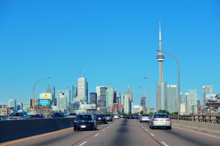 TORONTO, CANADA - JULY 3: Toronto highway with cityscape on July 3, 2012 in Toronto, Canada. Toronto with the population of 6M is the provincial capital of Ontario and the largest city in Canada. Stock Photo - 17635523