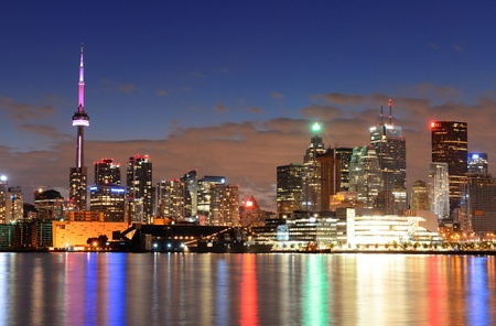 Toronto cityscape panorama at dusk over lake with colorful light. Stock Photo - 17640756
