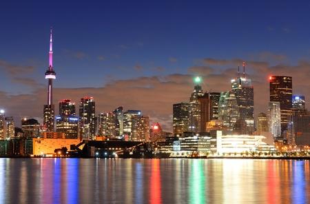 toronto: Toronto cityscape panorama at dusk over lake with colorful light. Stock Photo