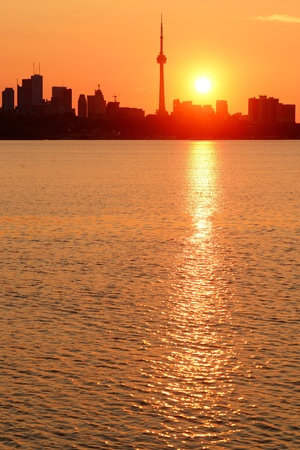 Toronto sunrise silhouette over lake with red tone. Stock Photo - 17640935