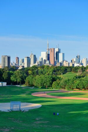 Toronto skyline over park with urban buildings and blue sky Stock Photo - 17640768