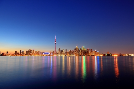 panorama city: Toronto cityscape panorama at dusk over lake with colorful light. Stock Photo