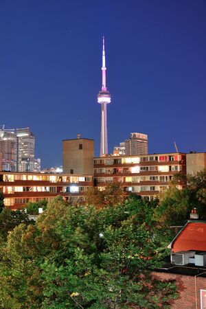 Toronto urban buildings over park with blue sky at night photo