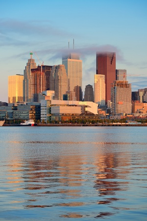Toronto sunrise with cloud and sunlight reflection over lake in the morning photo