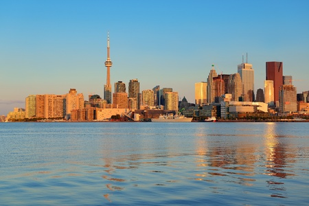 building cn tower: Toronto sunrise with sunlight reflection over lake in the morning