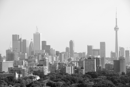 building cn tower: Toronto city skyline view with park and urban buildings in black and white Stock Photo