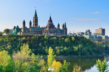 Ottawa cityscape in the day over river with historical architecture. photo