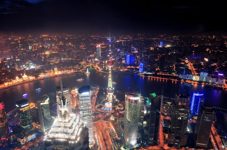 pudong district: Shanghai city aerial view at night with lights and urban architecture