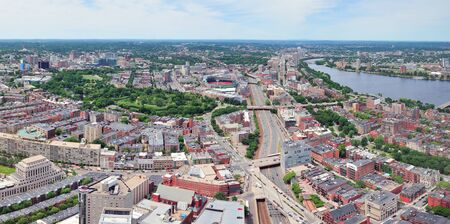 Boston city aerial panorama view with urban buildings and highway.  photo