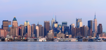 weehawken: New York City Manhattan sunset panorama with historical skyscrapers over Hudson River viewed from New Jersey Weehawken waterfront at dusk with tranquil blue tone.  Stock Photo
