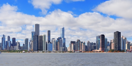 Chicago city urban skyline panorama with skyscrapers over Lake Michigan with cloudy blue sky  Stock Photo - 17645998