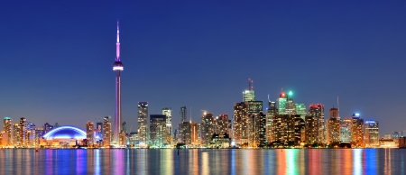 Toronto cityscape panorama at dusk over lake with colorful light. Stock fotó