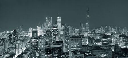 toronto: Toronto at dusk with city light and urban skyline with skyscrapers in black and white Stock Photo