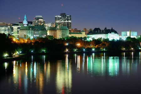 historic buildings: Ottawa at night over river with historical architecture.